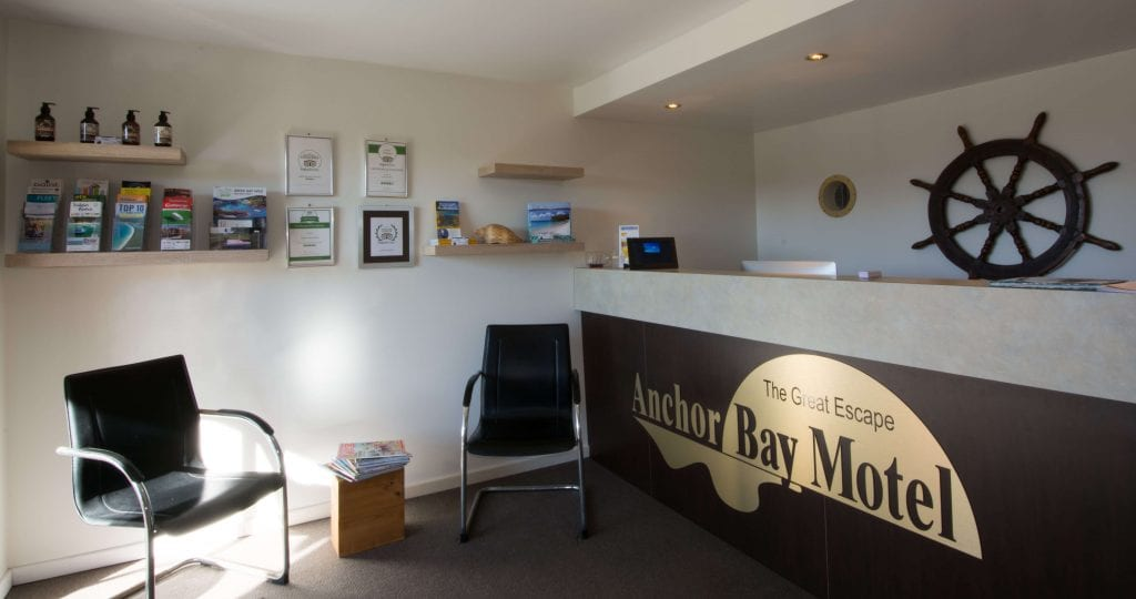 Reception office at Anchor Bay Motel with ships wheel.